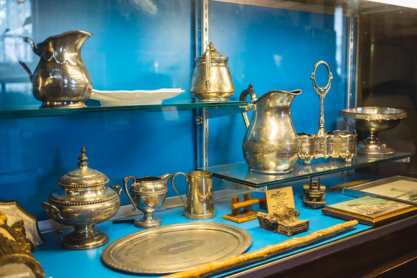 "Artifacts found on a steamboat called ""The Robert E. Lee"" shine in a display case at the Howard Steamboat Museum."