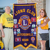 President of the Jeffersonville Lions Club Conrad Storz, left, and Chairperson of the club's sight program, JoEllen Blankenbeker stand behind their Lions Club banner outside of Boombozz Pizza & Taphouse in Jeffersonville on Friday. Staff Photo By Josh Hicks
