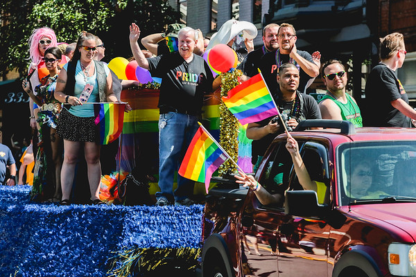 A float full of color leads the Jeffersonville Pride Parade down Spring Street on Saturday. Staff Photo By Josh Hicks