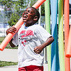 William English, 7, charges through a water obstacle course during Jeff Fest at Big 4 Station on Saturday. Staff Photo By Josh Hicks