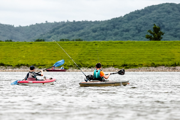 Seth Young, 13, and Kenton Pelsor, 13, paddle out to a fishing spot on Deam Lake on Thursday.