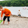 Tyson Frazer, 6, left, scoops up some sand on Deam Lake's beach as his brother Trevor Frazer, 4, draws in water to his hand dug moat on Thursaday.
