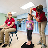 Natalie Schoen, 4, gets her height and weight recorded during the Head Start program at Community Action Southern Indiana on Wednesday. Staff Photo By Josh Hicks