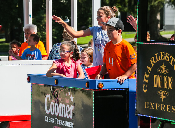 "Children throw candy from the ""Charlestown Express"" train-style float during the Charlestown Founder's Day parade."