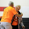 Florence Renn wins the trophy for being the oldest female competitor, at the age of 93, at the closing ceremony of the Senior Games at Sacred Heart in Jeffersonville on Friday. Pictured is Renn giving a hug to Clarence Schaftlein, the oldest male competitor. Staff Photo By Josh Hicks