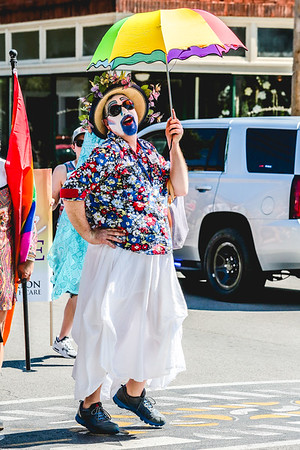 Sister Mary Ophelia Cox of the Derby City Sisters quickly strikes a pose during the Jeffersonville Pride Parade on Saturday. Staff Photo By Josh Hicks