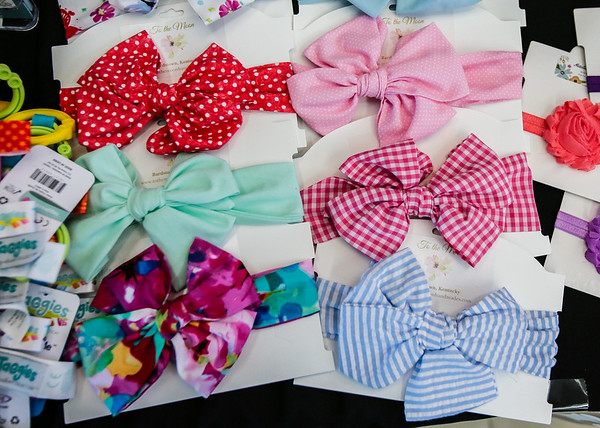 A variety of bows are arranged on the Oh Baby! Children's Boutique booth at the Baptist Health Floyd Baby Fair.