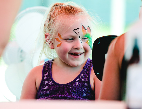Madelyn Nale, 4, smiles at her painted face in a mirror during Jeff Fest at Big 4 Station on Saturday. Staff Photo By Josh Hicks