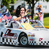 Sydney Harshey drives a small race car sponsored by Dixon Racing Supply during the Charlestown Founder's Day parade.