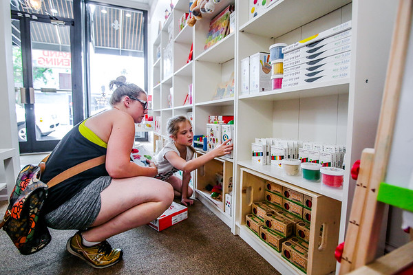 Kaeleen Gillette, left, and her daughter Emma, 8, look at toys at Brilliant Bumble Bee on Monday. Staff Photo By Josh Hicks
