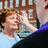 "Phyllis Ashby receives ashes from Wall Street United Methodist's Reverend Danyelle Ditmere. The Reverend set up ""Ashes to Go"" on the corner of Spring and Chestnut in Jeffersonville for Ash Wednesday. Staff Photo By Josh Hicks"