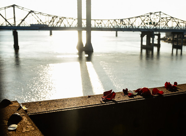 Rose petals rest on the metal foundation of the Big Four Bridge after being released by family and friends in celebration of the life of Ember Elizabeth Gooch, who passed away from a heroin overdose in September. Staff photo by Tyler Stewart