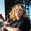 Amy Kaiser looks to family and friends before dropping rose petals from the Big Four Bridge in Jeffersonville on Tuesday. Kaiser, along with family and friends, celebrated the life of her daughter, Ember Elizabeth Gooch, who passed away after a heroin overdose in September. The celebration, It takes an Ember to light a fire, is working to raise money to be put toward Heroin Addiction awareness, prevention and treatment. Staff photo by Tyler Stewart