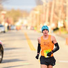 Jeremy Johnson finishes ahead of the pack, setting a new record of 9 minutes and 42 seconds for the annual Leprechaun Run in downtown Jeffersonville. Staff photo by Tyler Stewart