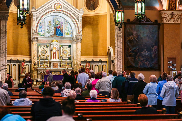 A long line forms to receive ashes for Ash Wednesday at St. Mary's Catholic Church. Staff Photo By Josh Hicks