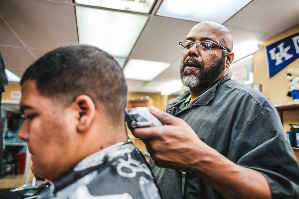 Veteran barber since 1992 Von Effinger gives Cobe Wilson a fade at Mark's Barber and Style in Jeffersonville on Wednesday. Four barbershops in New Albany and Jeff are participating in the Black Barbershop health initiative, which involves free health screenings and health info at barber shops. The Indiana Commission on the Social Status of Black Males began the initiative. Staff Photo By Josh Hicks