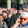 Abraham Lincoln blends into a sea of red hats outside of President Donald Trump's rally in Louisville on Monday. Staff Photo By Josh Hicks