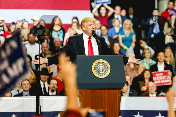 President Donald Trump extends his arm, greeting the crowd at the Kentucky Exposition Center on Monday. Staff Photo By Josh Hicks