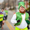 Chris Thomas races toward the finish line in his festive Irish costume after participating in the 2-mile annual Leprechaun Run on Tuesday in Jeffersonville. Staff photo by Tyler Stewart