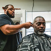 Cornell Chest gets a haircut from Walt at Mark's Barber and Style in Jeffersonville. Staff Photo By Josh Hicks