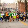 Runners begin the 2-mile Leprechaun Run along Chestnut Street in downtown Jeffersonville on Tuesday. Staff photo by Tyler Stewart