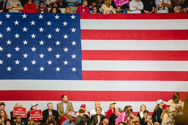 The upper and lower decks of the Louisville Expo Center fill up with supporters, framing a large American Flag during President Donald Trump's rally in Kentucky on Monday. Staff Photo By Josh Hicks