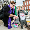 "Reverend Danyelle Ditmere sets up ""Ashes to Go"" on the corner of Spring and Chestnut in Jeffersonville for Ash Wednesday. Staff Photo By Josh Hicks"