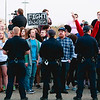 Police officers form a line in front of protesters who managed to approach the entrance of Freedom Hall at the Kentucky Exposition Center during President Donald Trump's rally in Louisville on Monday. Staff Photo By Josh Hicks