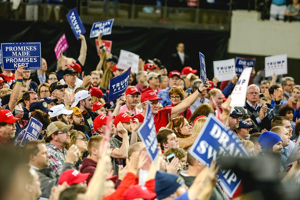 Crowds raise their signs in celebration during President Donald Trump's rally in Kentucky on Monday. Staff Photo By Josh Hicks