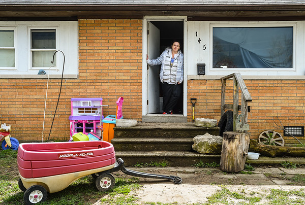 Cassie May stands in the doorway of her rental home at Pleasant Ridge in Charlestown. May, a tenant of the home along with her fiance, 3-year-old son and 10-year-old daughter, is one of about 50 individuals and families that will be displaced in preparation to redevelop the neighborhood. Staff photo by Tyler Stewart