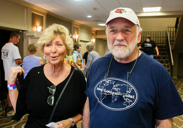 Maryann Scrivener, left, and Terry Singer wait to see Peter Asher outside the Royal Ball room at the Clarion Hotel in Clarksville on Saturday. Staff Photo By Josh Hicks