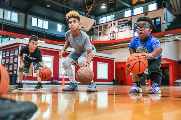 Amon Armour, 10, works on a dribbling exercise at Nachand Fieldhouse. Staff Photo By Josh Hicks