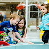 From left, Luke Herbert, 2, Madison Herbert, 5, and Anna Blades, 2, play in a small fountain at Clarksville Cove in the rain after the water park's ribbon cutting on Thursday. Staff Photo By Josh Hicks