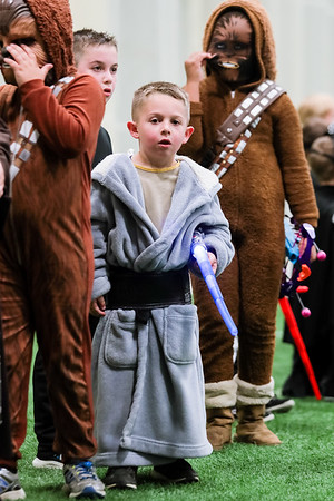 Levi Stone, 6, wears a robe in line for the costume contest at May the 4 Be With You on Thursday. Staff Photo By Josh Hicks