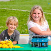 Siblings Townes Bartley, 5, left, and Lucia Bartley, 8, prepare drinks and snacks for Stop Addiction Walk participants on Saturday. Staff Photo By Josh Hicks
