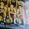 Another photo of Bob Potter on the Red Devils' 1953 team hangs above a basketball court at the Nachand Field House in Jeffersonville. Staff Photo By Josh Hicks