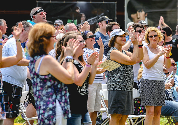 A crowd cheers for the Beatles tribute band Studio 2 during Abbey Road on the River on Saturday. Staff Photo By Josh Hicks