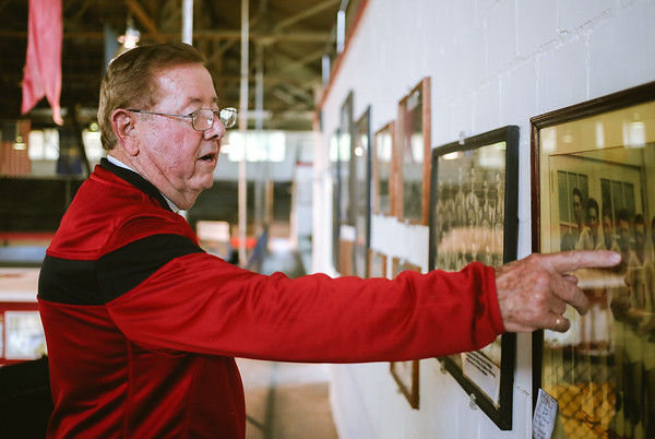 Bob Potter points out a photo of the 1931 Jeffersonville Red Devils at the Nachand Field House in Jeffersonville on Tuesday. Staff Photo By Josh Hicks