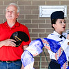 "County Commissioner Jack Coffman places his hat over his heart as Jeffersonville Air Force JROTC Cadet Airman First Class Maria Teles sings ""The Star-Spangled Banner"" during the Memorial Day service at the Clark County Government building on Monday. Staff Photo By Josh Hicks"