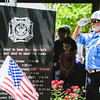 Color Guard member Allan Hinton saluts the a United States Flag as it flys at half mast during the Sellersburg Memorial Day service at Wilkerson Park on Monday. Staff Photo By Josh Hicks