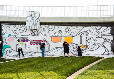 The Jeffersonville Art Alliance invites Abbey Road on the River attendees to paint a large submarine mural that hangs from the Big Four Bridge. Staff Photo By Josh Hicks