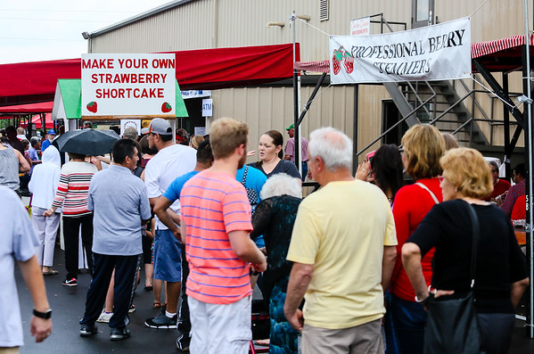 "A long line leading up to the ""make your own strawberry shortcake tent"" forms at the Starlight Strawberry Festival on Saturday. Staff Photo By Josh Hicks"