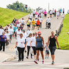 Stop Addiction Walk participants make their way back down a hill on the Ohio River Greenway in New Albany on Saturday. Staff Photo By Josh Hicks