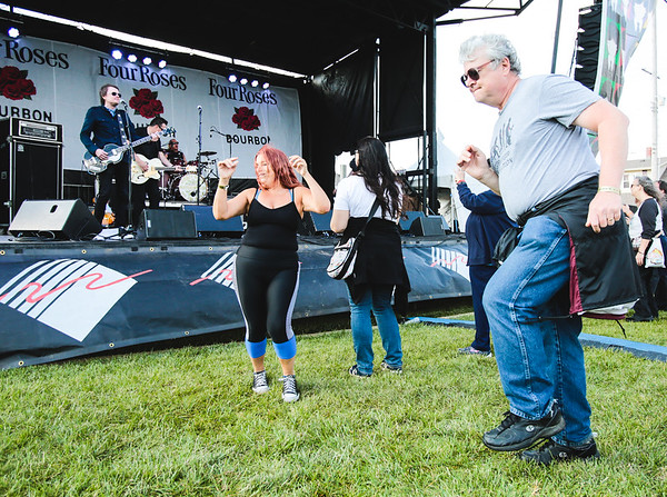 Fans dance to The Norwegian Beatles during the opening day of Abbey on the River at Big Four Station. Staff Photo By Josh Hicks