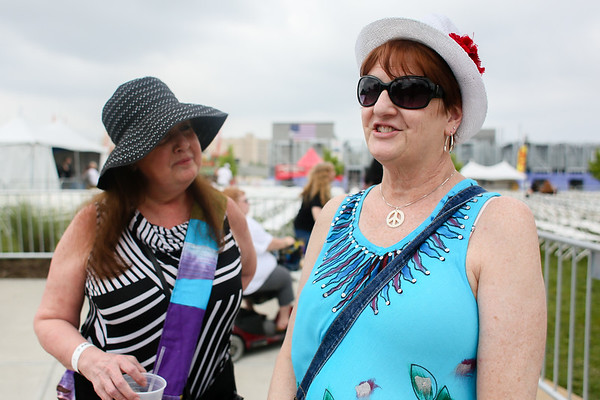 Cindy Vanvooren, left, and Barb Brooks drove from Cincinnati to attend Saturday's festivities at Abbey Road on the River. Staff Photo By Josh Hicks