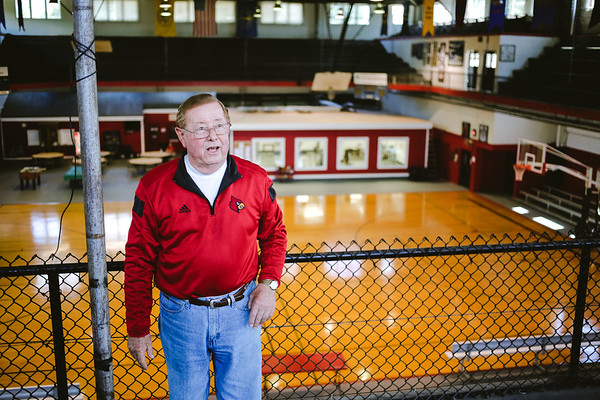 Bob Potter shares the history of the bleachers on the blacony at the Nachand Field House in Jeffersonville on Tuesday. Staff Photo By Josh Hicks