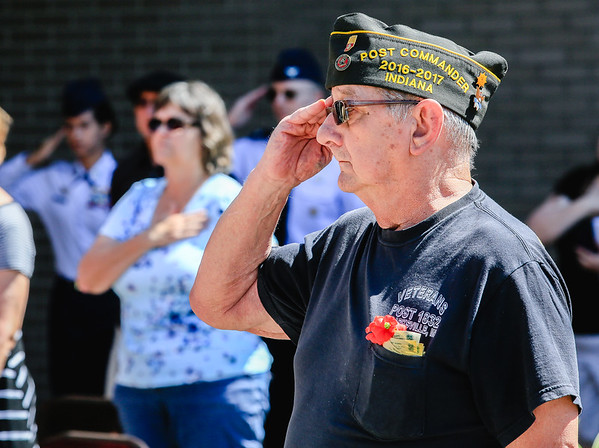 Army Veteran John Crumpton salutes the flag during the Memorial Day service held at the Clark County Government Building on Monday. Staff Photo By Josh Hicks