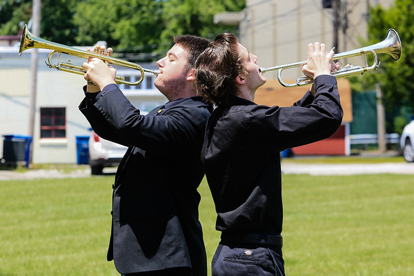 Andrew Smith, left, and Jason Crago perform taps during the Sellersburg Memorial Day service at Wilkerson Park on Monday. Staff Photo By Josh Hicks