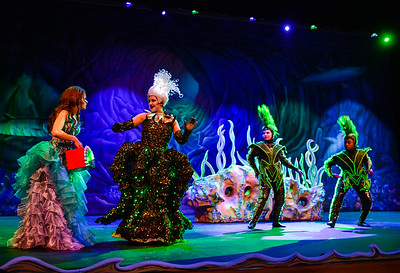 Arial, played by senior Chelsea Nevil, is greeted by Ursula the sea witch, played by senior Elizabeth Hop, after being lured to her cave by Flotsam and Jetsam, her eel assistants played by Maddy Cull and Bryson Barnett, during a dress rehearsal for Little Mermaid at New Albany High School. Staff photo by Tyler Stewart