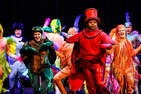 Junior James Buckle leads his fellow marine neighbors in dance while performing as Sebastian in New Albany High School's Little Mermaid dress rehearsal on Wednesday. Staff photo by Tyler Stewart